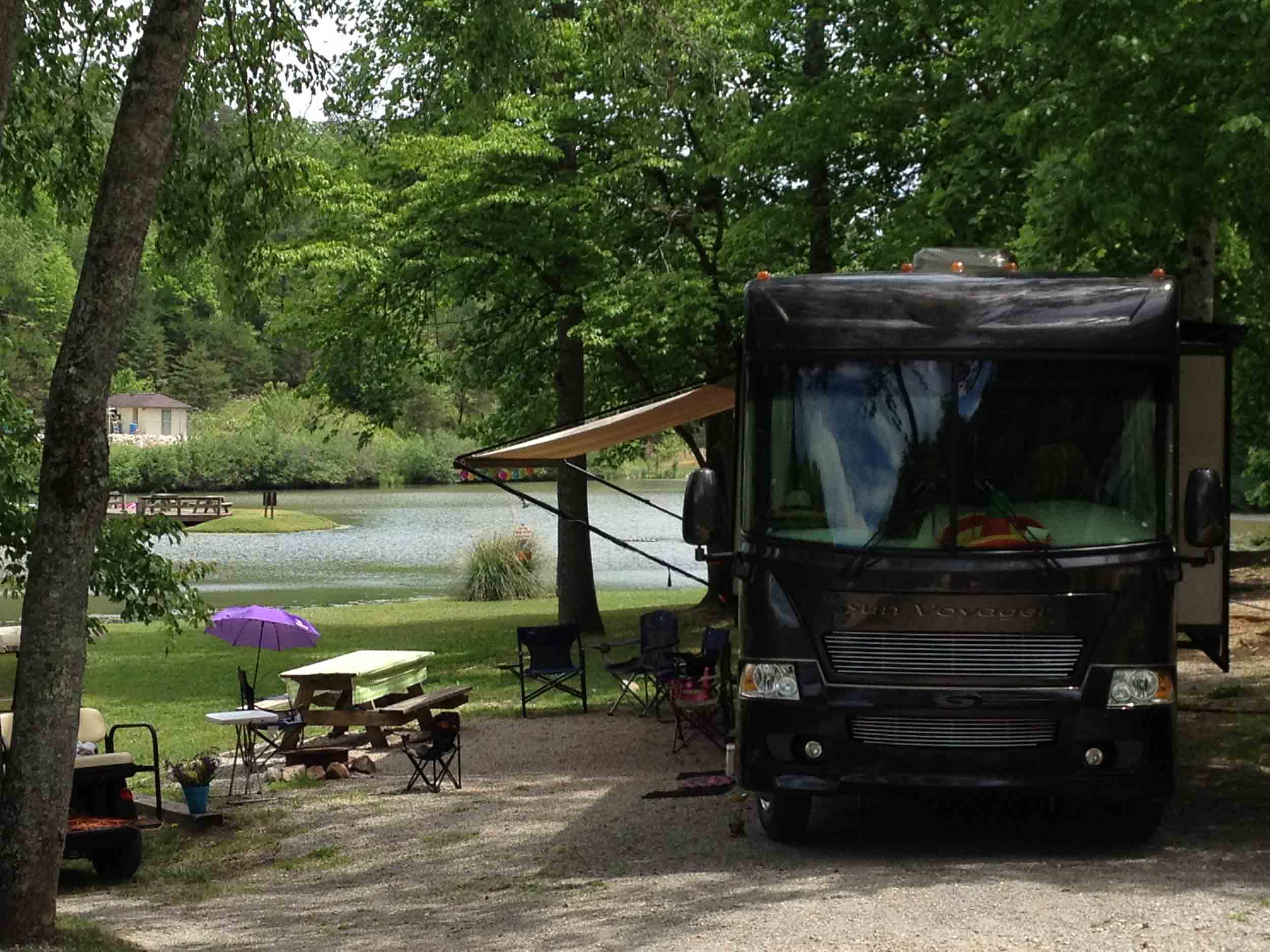 camper with awning at campsite