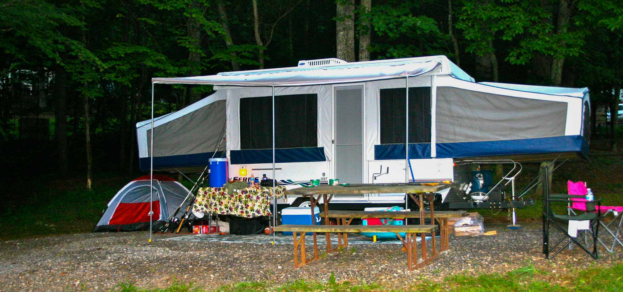 camper with tent and picnic table
