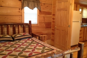 bedroom with quilt on bed